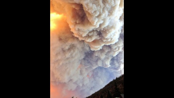 Smoke from the West Fork Fire Complex consisting of the West Fork and Windy Pass fires fills the sky on June 20.
