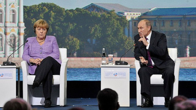 "Russia's President Vladimir Putin (R) and Germany's Chancellor Angela Merkel attend an International Economic Forum in St. Petersburg, on June 21, 2013. Putin and Merkel announced today that they would both attend the opening of a Saint Petersburg exhibition including treasures taken by the Red Army at the end of World War II. German officials had said earlier their visit to the ""Bronze Age of Europe -- Europe Without Borders"" exhibition at the Hermitage museum had been scrapped due to what German media said was a wrangle over the future of the so-called trophy art. AFP PHOTO / OLGA MALTSEVAOLGA MALTSEVA/AFP/Getty Images"