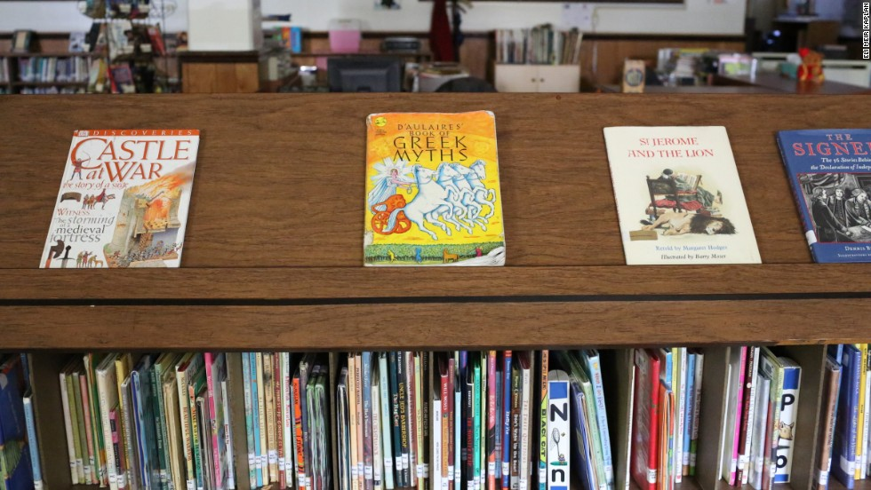 Books fill the library shelves at St. Jerome Academy. At many classical schools, students study Latin, memorize poetry and Shakespeare and focus on ancient history.
