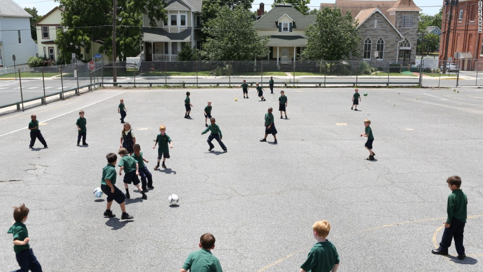 Students play soccer during recess at St. Jerome Academy.