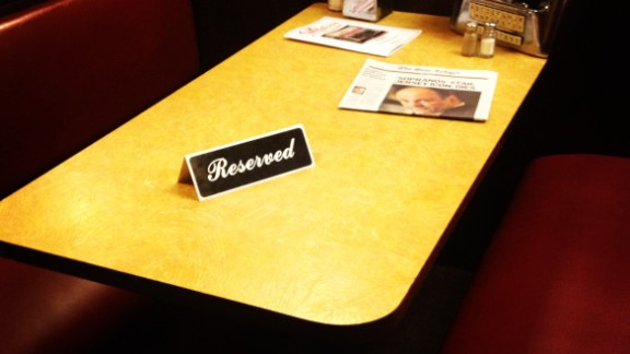 """Farley pointed out that, as of Wednesday night, """"Ice cream eaters can sit anywhere but the booth that Tony Soprano sat in during the very last episode. A reserved sign sits on the table alongside a newspaper dedicated to Gandolfini."""""""
