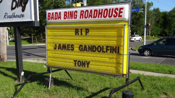 """Art Frewin named his Wellin, Ontario, bar the """"Bada Bing Roadhouse,"""" inspired by """"The Sopranos,"""" and paid tribute on the sign outside his establishment when he heard the news. """"I was sorry to see Tony ... James pass away. We'll always know him as Tony, you know. I thought he was a brilliant actor who played a brilliant part. I was very taken aback. 51 is way too young."""""""