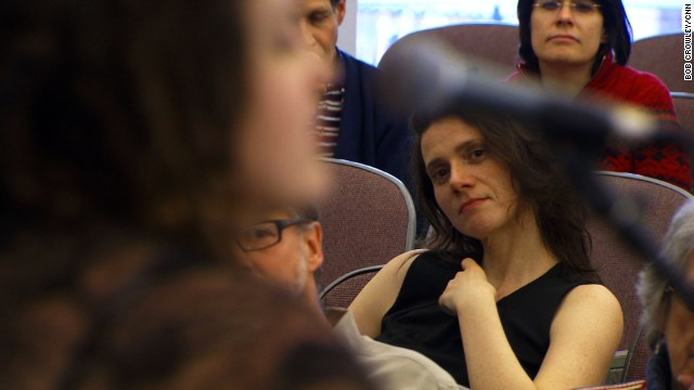 Members of an atheist congregation at Harvard listen to music during a gathering.