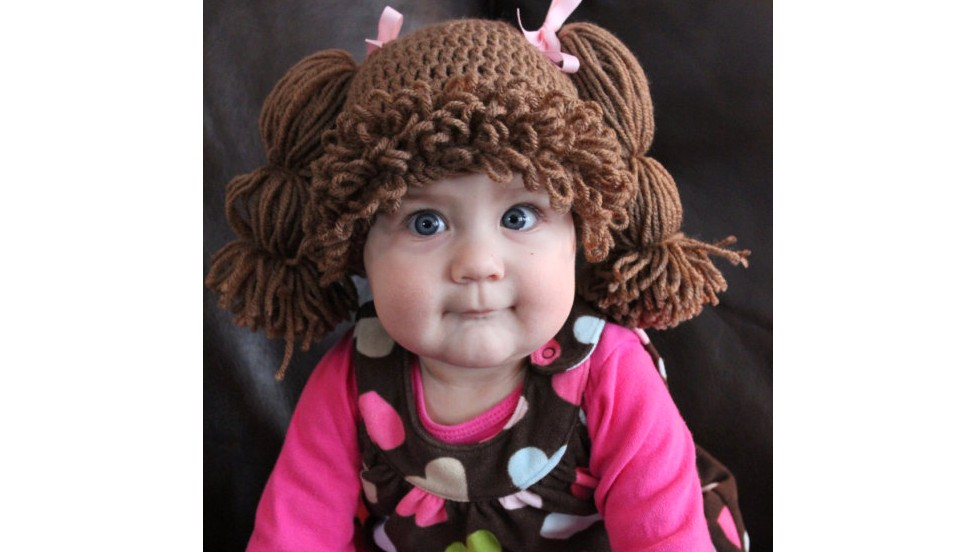 Wigs make babies look like dolls from the 80s.