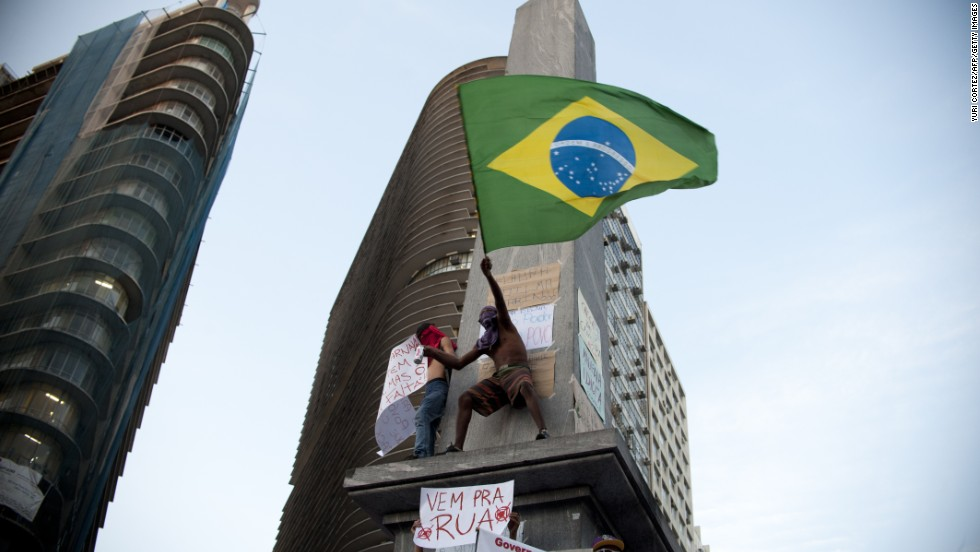A demonstrator waves the Brazilian flag during the 2013 protests in Belo Horizonte, where thousands marched.<br /><br />
