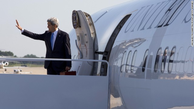 Secretary of State John Kerry waves Friday before boarding a plane to travel to Qatar.