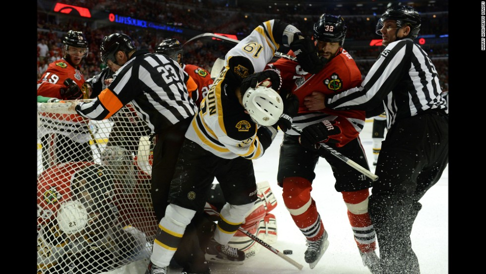 The Bruins' Tyler Seguin fights with the Blackhawks' Michal Rozsival.
