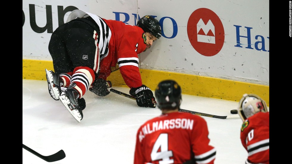Brent Seabrook of the Chicago Blackhawks crashes into the board.
