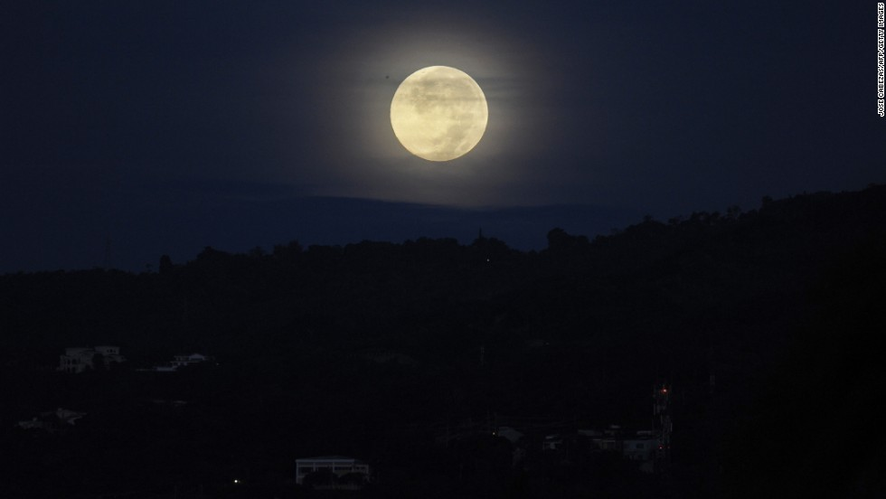 The moon lights the sky over San Salvador, the capital of El Salvador, on June 23.