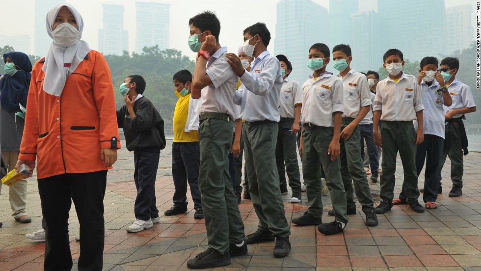 Students wear masks as haze shrouds Kuala Lumpur on June 23. Many schools in Malaysia were closed on Monday after air pollution caused by forest fires in Indonesia spiked to hazardous levels.