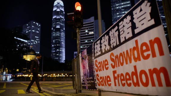 Analysts say Hong Kong's pointed questions over cyber-hacking are aimed at placating domestic concerns.