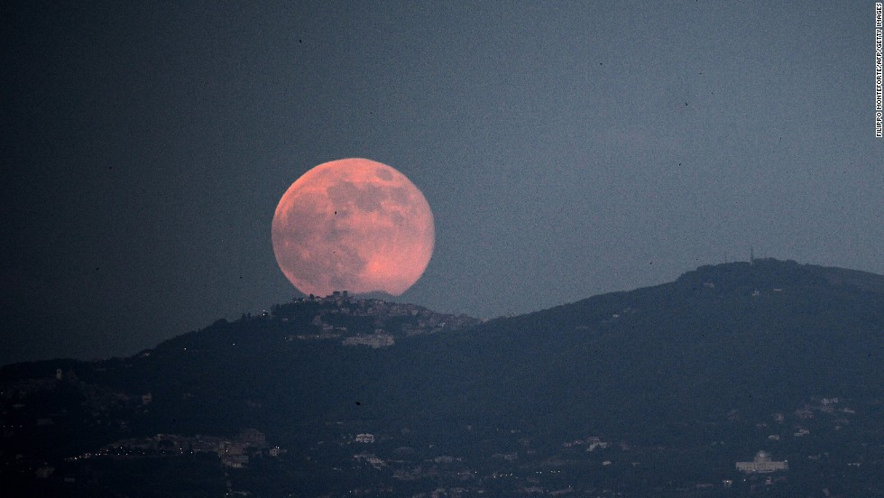 The supermoon rises over Rome on June 23.