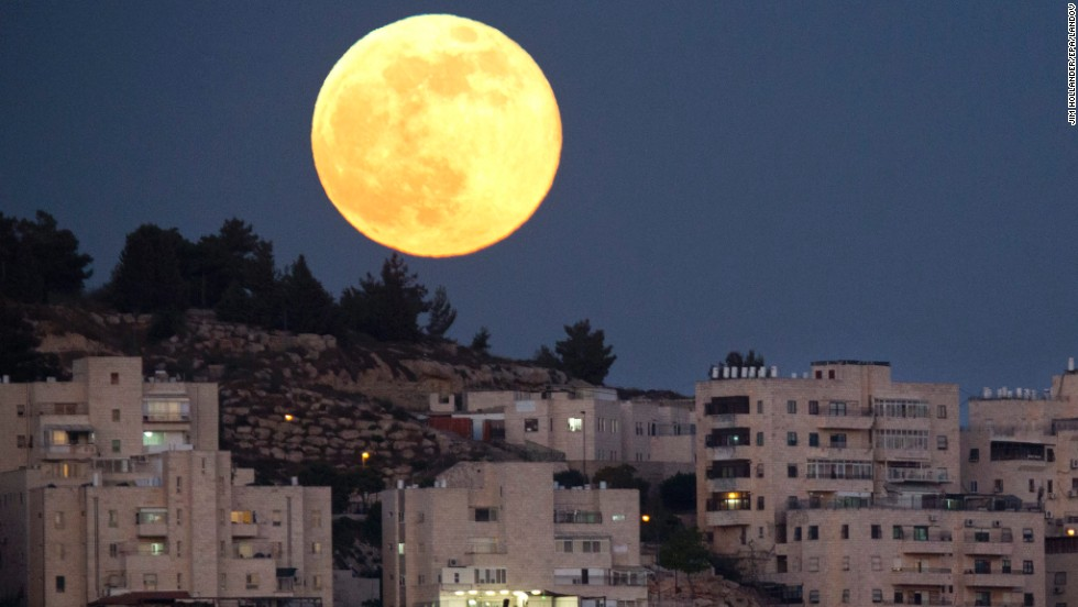 "The biggest and brightest moon of the year rises over a Jerusalem neighborhood on Sunday, June 23. The magic moment happened early June 23, 2013, when<a href=""http://www.cnn.com/2013/06/22/us/supermoon-sunday/index.html""> the moon was at the closest point to Earth in its orbit</a>.  A supermoon, which occurs once a year, is 14% larger and 30% brighter than most full moons, <a href=""http://moon.nasa.gov/newsdisplay.cfm?Subsite_News_ID=44049&SiteID=6&iSiteID=1"" target=""_blank"">according to NASA</a>."