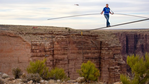 Nik Wallenda nears the completion of his quarter-mile walk near the Grand Canyon in June 2013 in Arizona. He crossed the Little Colorado River Gorge without the aid of a safety tether. He is a member of the famous Flying Wallendas, founded by his great-grandfather Karl in the 1920s, and also walked across Niagara Falls last year.
