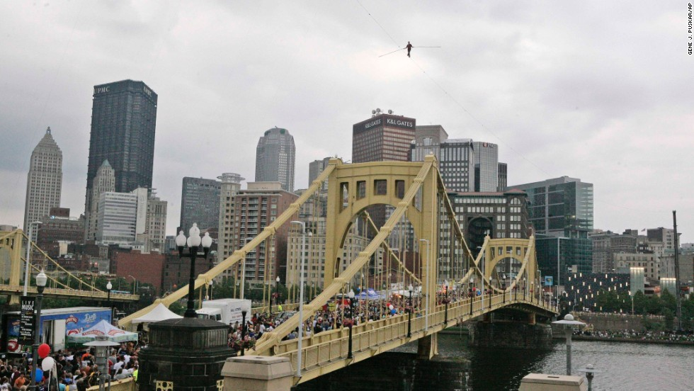 Wallenda walks a 1,000-foot-long high-wire suspended 200 feet over the Allegheny River in Pittsburgh in July 2009.