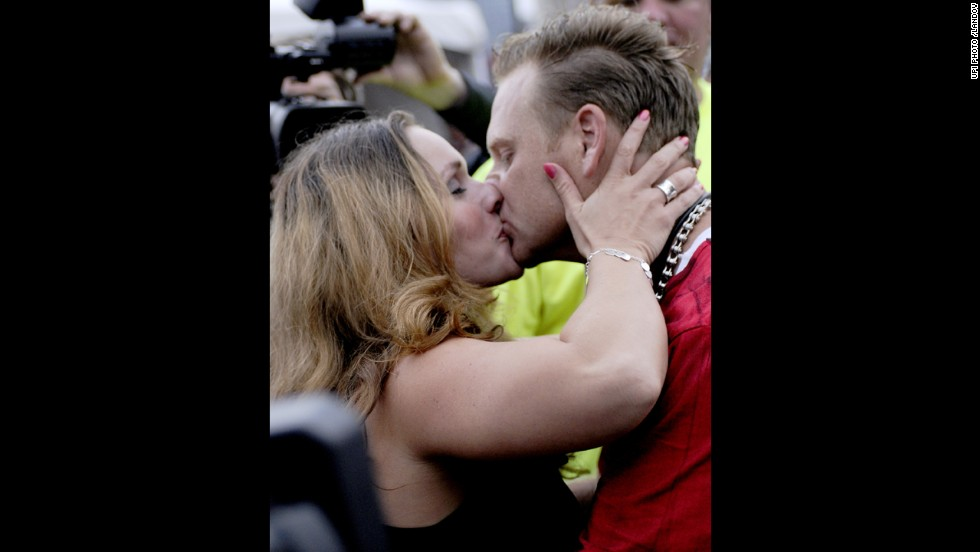 Wallenda kisses his wife, Erendira, after the stunt above the Allegheny River in Pittsburgh in July 2009.