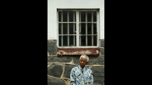 Nelson Mandela speaks outside his former prison cell during a press conference in 2003 on Robben Island, off the coast of Cape Town, South Africa. From the mid-1960s through 1991, the island served as a maximum-security prison, mostly housing offenders of political offenses. Mandela spent 18 of his 27 years in prison on Robben Island. From 1964 to 1982, Mandela was incarcerated at Robben Island Prison in the cell shown. In 1990, he was freed.