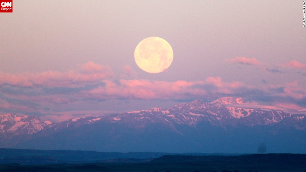 "<a href=""http://ireport.cnn.com/docs/DOC-993766"">Jon Pierce </a>woke early to catch the supermoon. At 5 a.m., he stood outside his home with a camera in hand to photograph it above the Rocky Mountains in Billings, Montana. ""The fact that the moon was setting and the sun was rising all over the Rockies is what fascinated me the most,"" he said."