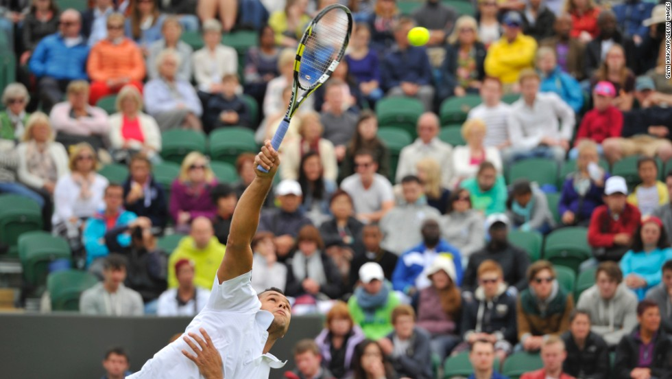 Tsonga serves against Goffin during their first-round match on June 24.