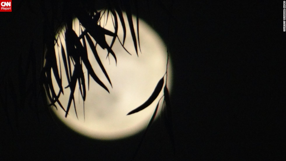 "<a href=""http://ireport.cnn.com/docs/DOC-993848"">Munawar Ahmed </a>photographed the Supermoon in Lahore, Pakistan. ""I love to work on the beautiful nature of God, and capturing beautiful effects is my hobby, which gives me a lot of energy and refreshes my mind, heart and soul,"" he said."