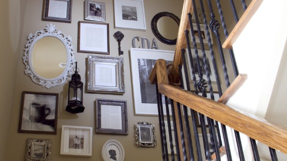 Anisa Darnell's Roswell, Georgia, home came with a huge blank wall along the staircase. She filled it with a collage that is a tribute to her family.