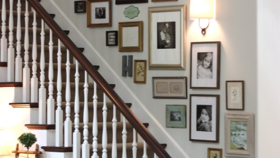 Jill Hinson's Portland, Oregon, house wasn't a home until she installed this gallery on the stairwell wall.