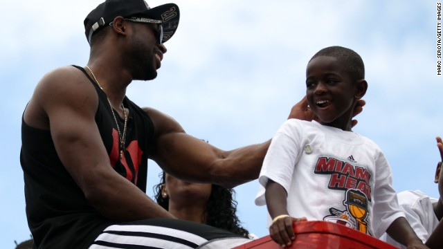 Dwyane Wade and his son ride in the Miami Heat NBA Championship victory parade in June.