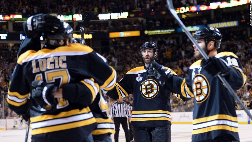 Milan Lucic of the Boston Bruins, left, celebrates with his teammates after scoring a goal in the third period.