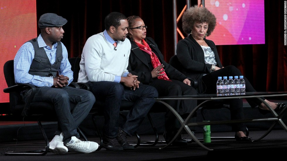 "From left, Kweli, filmmakers Shukree Hassan Tilghman and Sharon La Cruise and activist Angela Davis at a Black History Month panel last year. The rapper often addresses the plight of African-Americans in his songs, once rhyming, ""N****s with knowledge is more dangerous than n****s with guns/They make the guns easy to get and try to keep n****s dumb."""