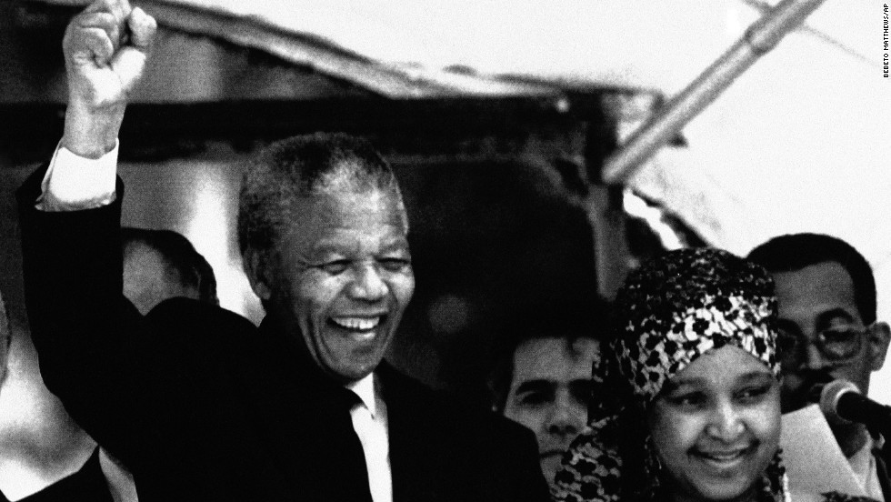 Mandela and his wife react to supporters during a visit to Brazil at the governor's palace in Rio De Janeiro, on August 1, 1991.