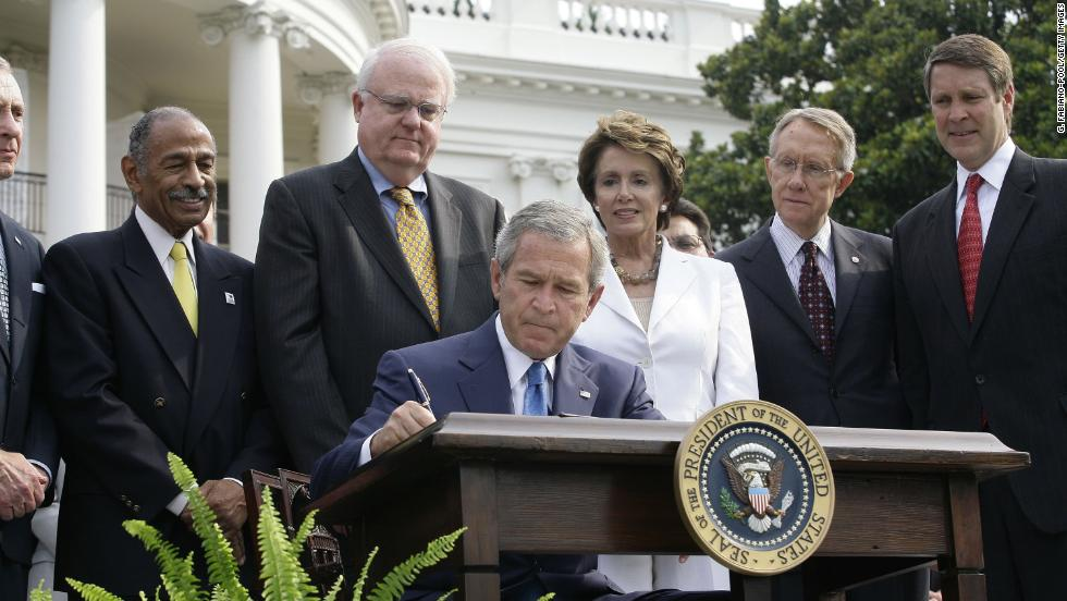 President George W. Bush signs reauthorization of the act on July 27, 2006. From left, Rep. John Conyers, D-Michigan, Rep. James Sensenbrenner, R-Wisconsin, House Minority Leader Nancy Pelosi, D-California, Sen. Harry Reid, D-Nevada, and Sen. Bill Frist, R-Tennessee, look on.