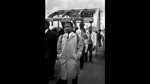 "John Lewis, a young activist who later became a congressman of Georgia, heads to a fateful encounter on the Edmund Pettus Bridge in Selma, Alabama during a 1965 march. Lewis was brutally assaulted by state troopers during the ""Bloody Sunday"" march that made voting rights a national issue."