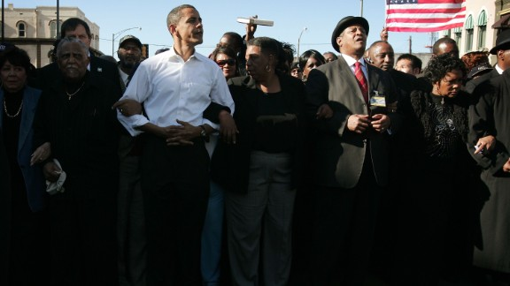 President Barack Obama marches with civil right veterans during a commemoration march in 2007.