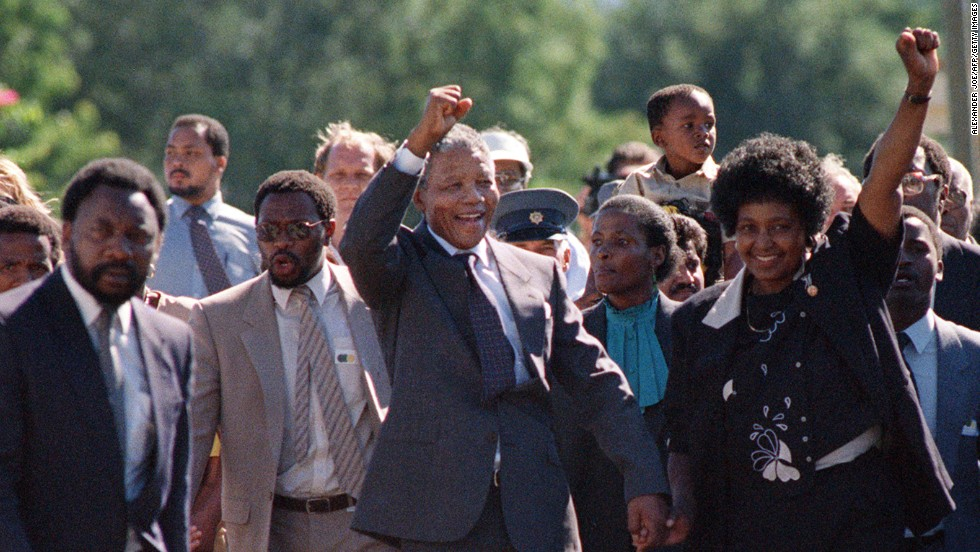 Nelson and Winnie Mandela raise their fists to salute a cheering crowd upon his 1990 release from Victor Verster Prison. He was still as upright and proud, he would say, as the day he walked into prison 27 years before.