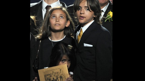 """Paris, Prince and Blanket attend the memorial service for Michael Jackson at the Staples Center in Los Angeles on July 7, 2009. Paris paid tribute to her father by saying, """"Ever since I was born, daddy has been the best father you could ever imagine ... I just want to say I love him so much."""""""