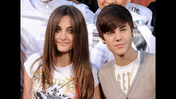 """Paris poses with Justin Bieber at the Michael Jackson hand and footprint ceremony at Grauman's Chinese Theatre in 2012. Bieber has called Jackson """"<a href=""""http://watch.accesshollywood.com/video/justin-bieber-on-michael-jacksons-legacy:-he-was-an-inspiration/1416520384001?utm_source=accesshollywood.com&utm_medium=referral"""" target=""""_blank"""" target=""""_blank"""">an inspiration and an icon</a>."""" (The famous landmark is now called TCL Chinese Theatre)."""