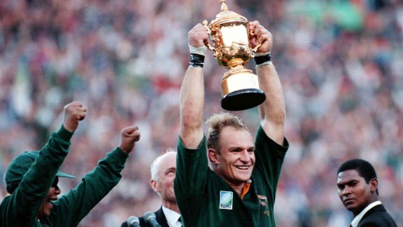 Mandela, left, cheers as Springbok Rugby captain Francois Pienaar holds the Webb Ellis trophy high after winning the World Cup Rugby Championship in Johannesburg on June 24, 1995.