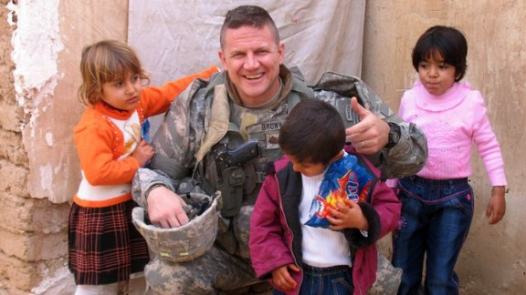 Col. Kevin Brown with Iraqi kids in Kirkuk in 2007. Brown helped  ensure Baby Noor came to the U.S. for medical help.