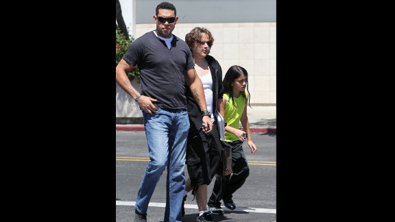 """Prince and Blanket are photographed for the first time since Paris was hospitalized, <a href=""""http://www.cnn.com/2013/06/07/showbiz/paris-jackson-probe"""">where she remains today</a>."""