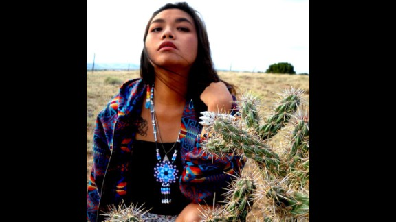 """Paul Frank Industries is collaborating with four Native American artists on a limited edition line of clothing and accessories, set to debut in August.  Autumn Dawn Gomez is a jewelery designer from the Comanche/TaosPueblo/Navajo tribes. For """"Paul Frank Presents"""" she is designing accessories influenced by various landscapes that have impacted her life. Gomez is seen here wearing a medallion she created using hama fuse beads."""