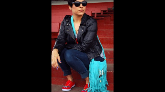 Candace Halcro is an accessories designer from the Plains Cree/Metis tribe. She is skilled in Native American beading and specializes in sunglasses. Halcro will be applying her beading craft to Paul Frank sunglasses for the collection. She's seen here wearing beaded shoes, a purse and sunglasses that she created.