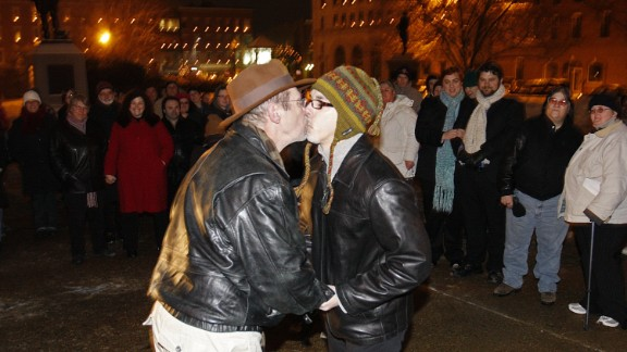 Olin Burkhart, left, and Carl Burkhart kiss on the steps of the New Hampshire Capitol on January 1, 2010, after the state