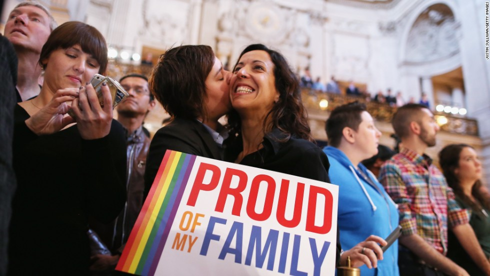 A couple celebrates at San Francisco City Hall upon hearing about the U.S.  Supreme Court rulings