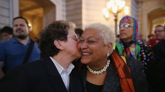 A couple celebrates at City Hall in San Francisco after hearing the Supreme Court struck down parts of the Defense of Marriage Act.