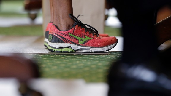 Texas state Sen. Wendy Davis wears running shoes in place of her dress shoes during her one-woman filibuster in an effort to kill an abortion bill on Tuesday, June 25, in Austin, Texas. The shoes became a symbol of the #standwithwendy movement.