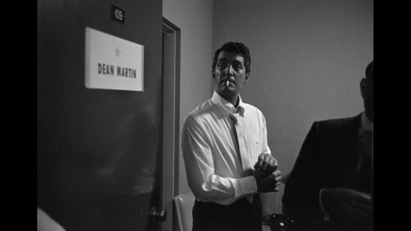Dean Martin adjusts his cuff links backstage before a performance in Las Vegas in 1958.