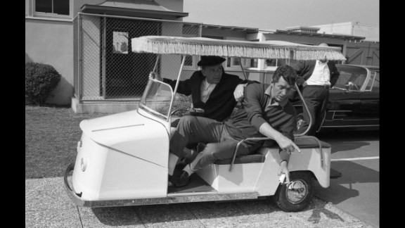 Frank Sinatra and Dean Martin tool around the Warner Bros. lot while making 1965