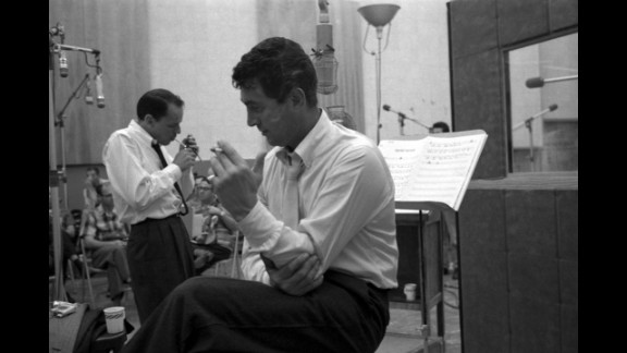 Sinatra and Martin take a cigarette break during the recording of Sleep Warm in 1958. The album was re-released in 1963 with a much more direct title: Dean Martin Sings/Sinatra Conducts.