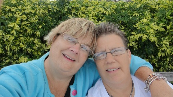 "Sara Hayden, left, and partner Darcy Schriever hope the ruling means ""we have a chance to open the door (for same-sex marriage) in Florida."""