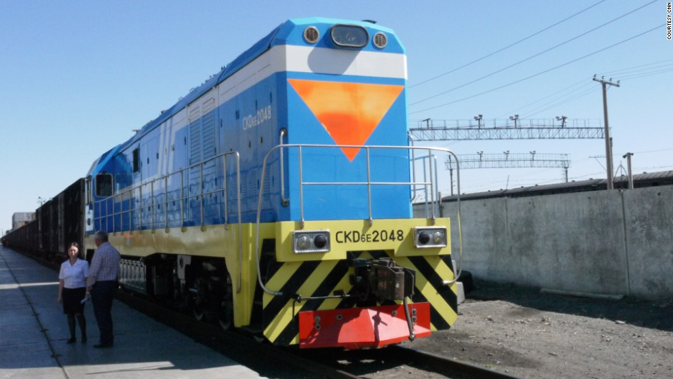 "A locomotive designed to run on ""wide gauge"" Kazakh and Russian track. Throughout the course of the cargo's journey along the Southern Route the driver and locomotive will change several times."